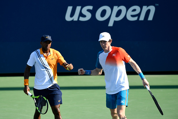 Nicholas Monroe and John-Patrick Smith fist bump after taking the second set (Photo: Sarah Stier/Getty Images)