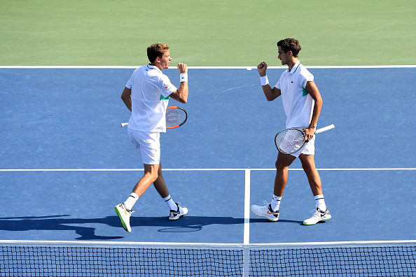 Pierre-Hugues Herbert and Nicolas Mahut sent the game to a decider but couldn't come away with the win (Photo: Sarah Stier/Getty Images)