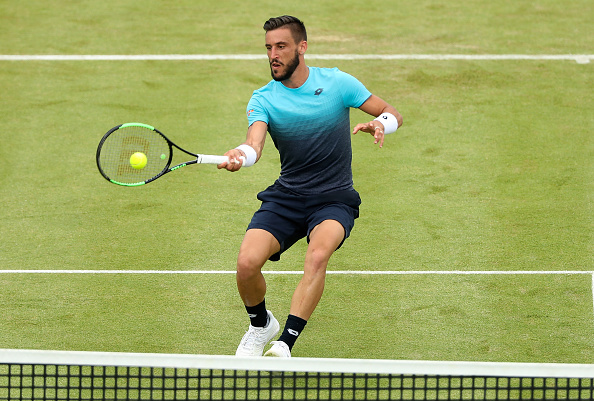 Damir Dzumhur plays a shot at the Fever-Tree Championships (Photo: Matthew Stockman/Getty Images)