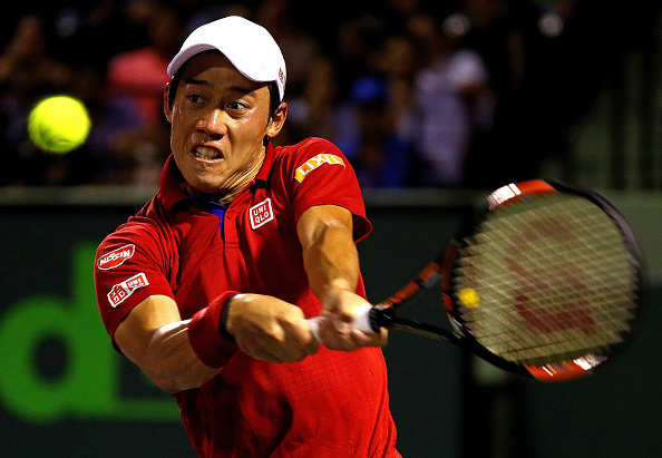 Nishikori rips a backhand for a winner down-the-line. Credit: Mike Ehrmann/Getty Images