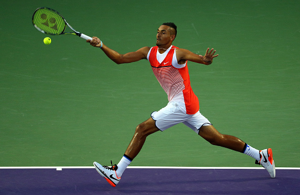 Kyrgios stretches out to reach the ball before hitting the forehand. Credit: Mike Ehrmann/Getty Images