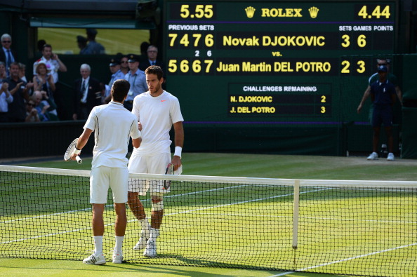 Del Potro and Djokovic meet at the net after their gruelling semifinal at Wimbledon in 2013 (Getty/Mike Hewitt)