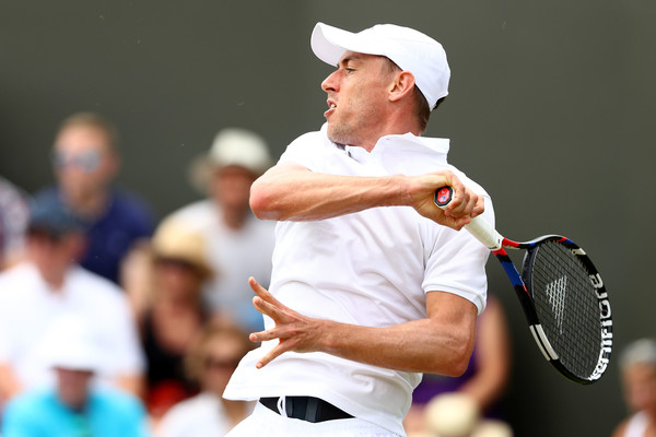 John Millman follows through on a forehand. Generally he out-rallied Raonic in the early stages of the match. Photo: Matthew Stockman/Getty Images