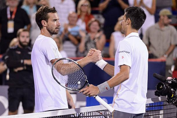 Ernests Gulbis and Novak Djokovic meet at the net after their match at the Rogers Cup in 2015 (Getty/Minas Panagiotakis)