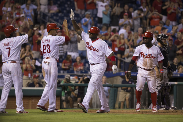 The Philadelphia Phillies celebrating a grand slam by Ryan Howard. Photo Credit: Mitchell Leff of Getty Images
