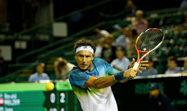 Juan Monaco plays a backhand during his opening match. Photo: US Men's Clay Court Championship