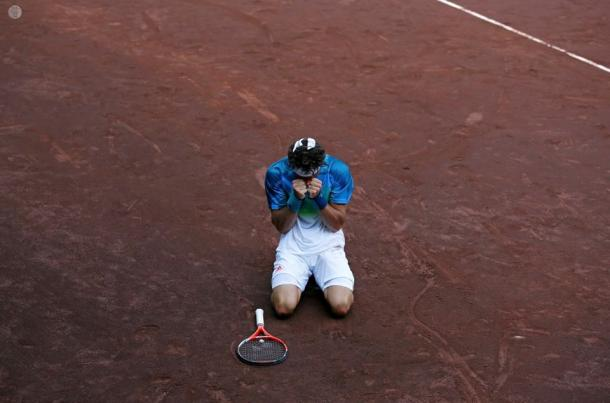 Monaco drops to his knees after clinching the title. Photo: Aaron M. Sprecher/ROCC