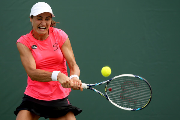 Monica Niculescu hits a backhand. Photo: Matthew Stockman/Getty Images North America