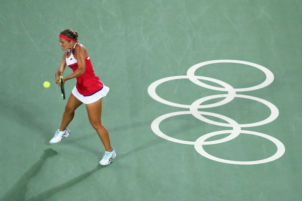 Monica Puig celebrates hits a backhand during her women's singles gold medal match against Angelique Kerber on Day 8 of the Rio 2016 Olympic Games. | Photo: Dean Mouhtaropoulos/Getty Images South America