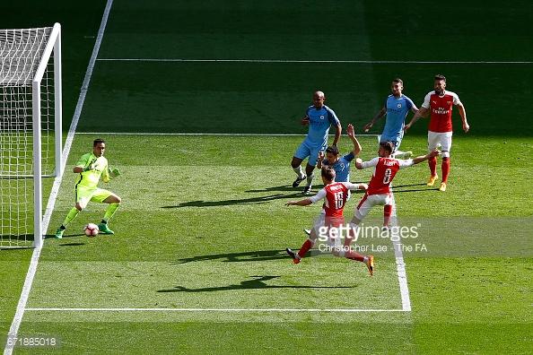 Monreal strikes it past Bravo | Photo: Christopher Lee - The FA via Getty Images