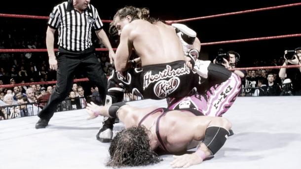 Michaels applies the Sharp Shooter to hart at the infamous Montreal Screwjob (image: cagesideseats.com)