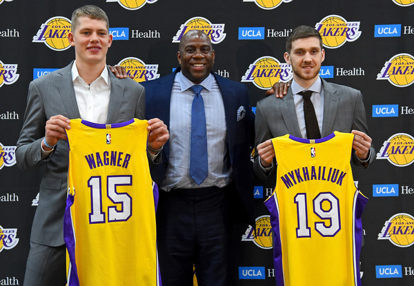 Magic Johnson, the Los Angeles Lakers president of basketball operations, stands with the team's 2018 NBA draft picks Moritz Wagner and Sviatoslav Mykhailiuk during an introductory press conference |Jayne Kamin-Oncea/Getty Images North America|