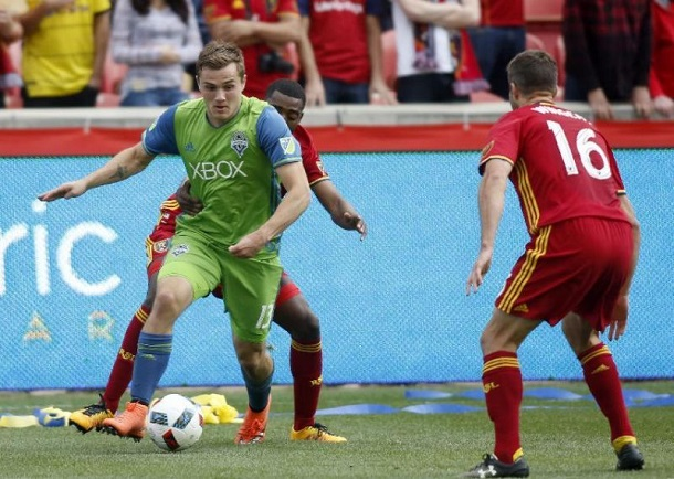 Seattle's Jordan Morris takes on Real Salt Lake's Aaron Maund and Chris Wingert | Photo: AP Photo/Kim Raff