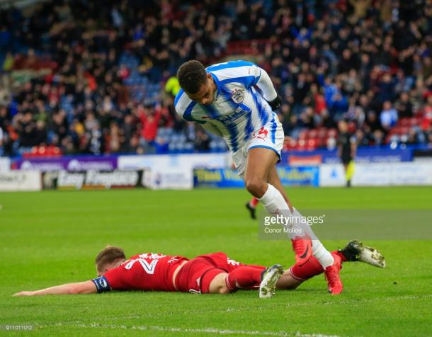 27th January 2018, John Smith's Stadium, Huddersfield, England; FA Cup football, 4th round, Huddersfield Town versus Birmingham City; Steve Mounie of Huddersfield Town turns to celebrate as he scores the opening goal of the game in the 20th minute (Photo by Conor Molloy/Action Plus via Getty Images)