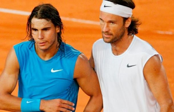 Nadal (left) and Moya meet at the net after Nadal's victory over his mentor in 2008. Photo: Fabian Bimmer/AP