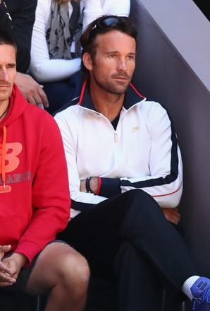 Carlos Moya looks on during Raonic's second round match in Madrid. Photo: Julian Finney/Getty Images