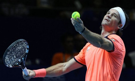Carlos Moya lines up a serve in the opening set of the Slammers match on Wednesday. Photo: IPTL