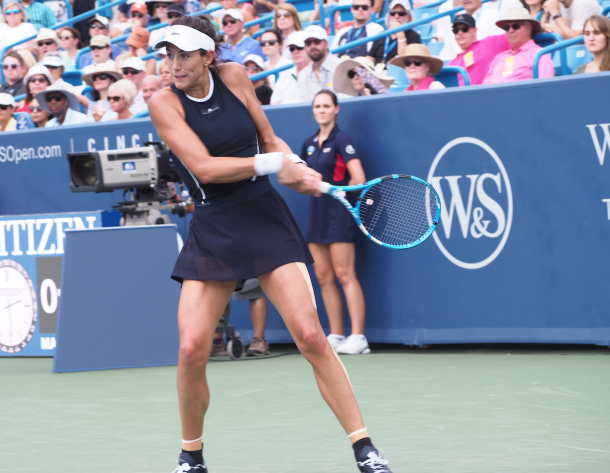 Muguruza lines up a backhand during her finals victory. Photo: Noel Alberto