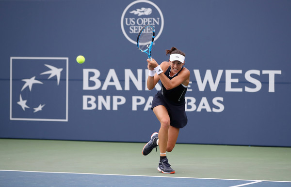 Muguruza chases down a backhand. Photo: Ezra Shaw/Getty Images