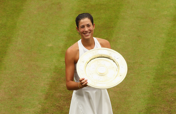 Muguruza holds her Wimbledon trophy last month after defeating Venus Williams for the title. Photo: Clive Brunskill/Getty Images