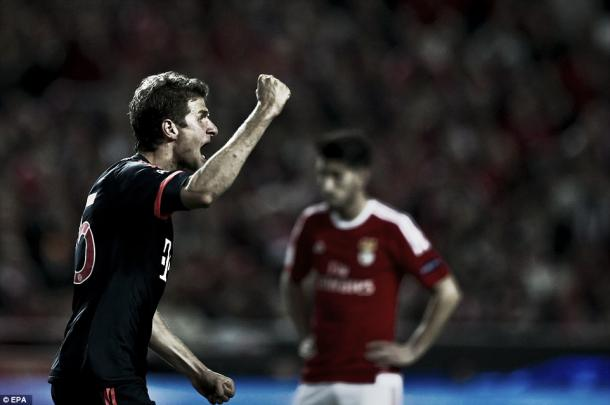 Above: Thomas Muller celebrates Bayern Munich's second goal in their 2-2 draw with Benfica | EPA