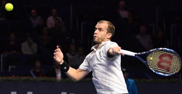 Gilles Muller hits a forehand during his upset win. Photo: Swiss Indoors