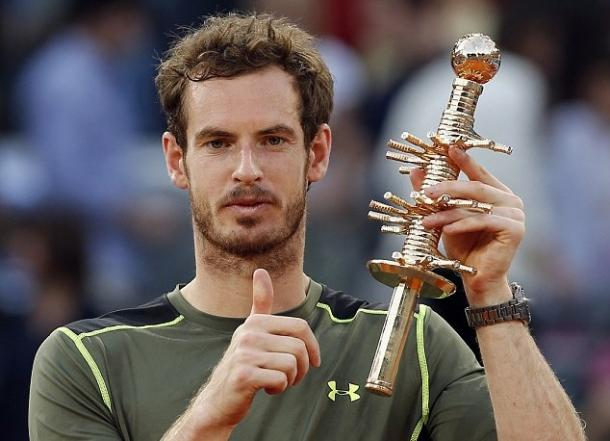 Andy Murray poses with the trophy after winning in Madrid last year. Photo: AP