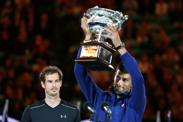 Murray (left) looks on as Novak Djokovic lifts the trophy after their Australian Open final. Photo: Scott Barbour/Getty Images