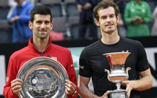 Murray and Djokovic hold their trophies in Rome after the Scot's victory in May. Photo: EPA