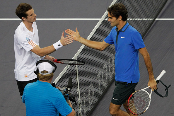 Murray (left) and Federer shake hands after Murray beat Federer at Shanghai in 2012. Photo: Lintao Zhang/Getty Images