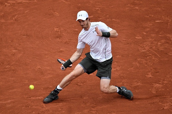 Murray slides into a forehand. Photo: Philippe Lopez/AFP/Getty Images