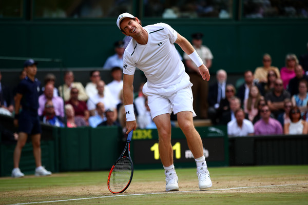 Andy Murray winces in obvious pain during the 2017 quarterfinal loss at Wimbledon, his last match before shutting down for 11 months to recover from his hip injury. Photo: Clive Brunskill/Getty Images