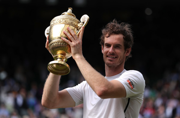 Andy Murray hoists his trophy last year at Wimbledon. Photo: Getty Images