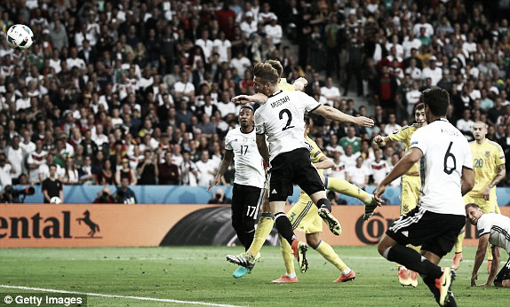 Above: Shkodran Mustafi heads home in Germany's 2-0 win over Ukraine | Photo: Getty Images