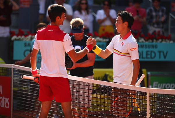 Djokovic and Nishikori embrace at the net (Image source: Clive Brunskill/Getty Images Europe)