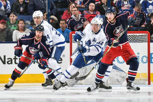 The two teams battle for position in front of the net. (Jamie Sabau/NHLI via Getty Images)