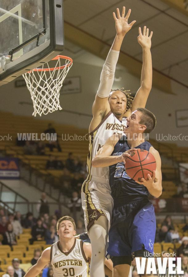 Alec Marty (22) go's to the basket while Brandon Johnson (35) go's for the block. Photo: Walter Cronk
