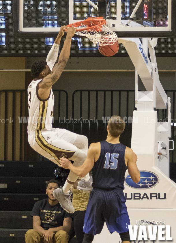 Josh Davis (3) gets the open dunk as Brad Schaub (15) looks on. Photo: Walter Cronk