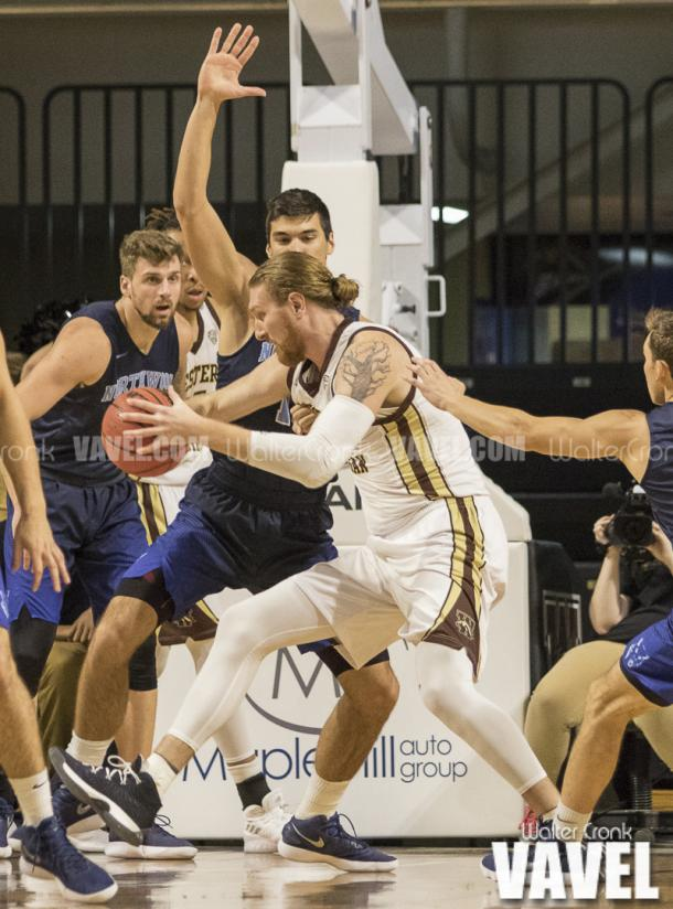 Drake LaMont (42) go's to the basket against David Jelinek (13). Photo: Walter Cronk
