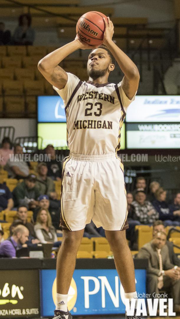 Reggie Jones (23) takes the wide open shot. Photo: Walter Cronk