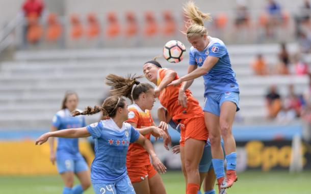 Alyssa Mautz (right) challenges for a header against the Houston Dash last week. Source: Chicago Red Stars