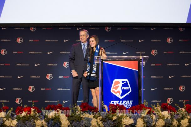 Plush with the first overall pick, Rose Lavelle, at this year's draft | Source: Jenny Chuang/VAVEL