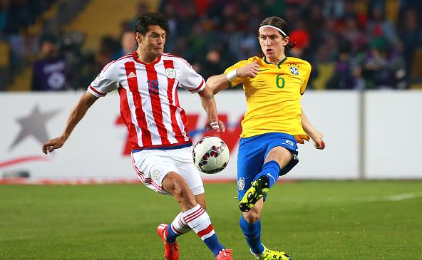 Nelson Valdez (left) during a 2015 Copa America Chile quarter final match against Brazil / Hector Vivas - LatinContent/Getty Images