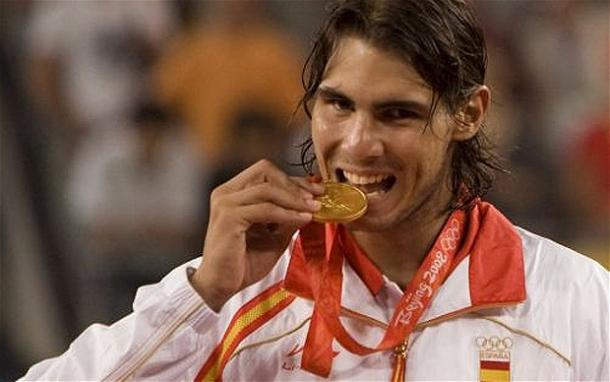 Nadal bites his gold medal in Beijing. Photo: EPA