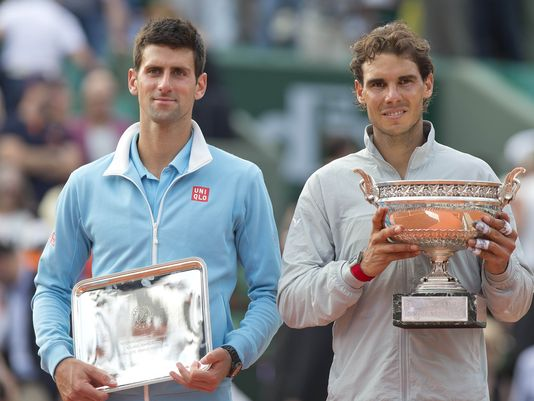 Nadal (left) and Novak Djokovic pose with their trophies after the 2014 French Open final. Photo: Susan Mullane/USA Today Sports