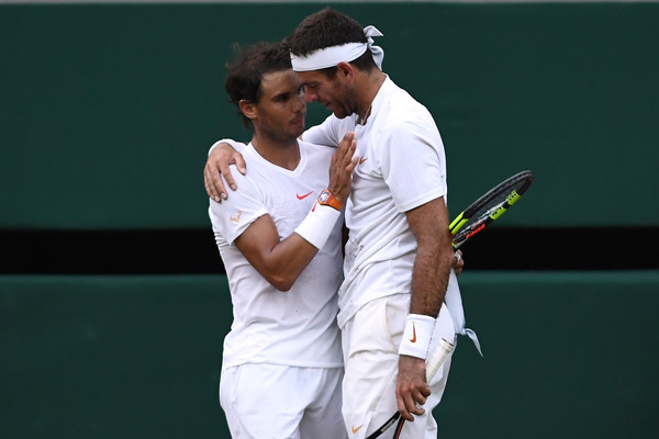 Nadal (left) and del Potro embrace after their epic quarterfinal. Photo: Clive Brunskill/Getty Images