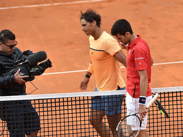 Nadal and Djokovic (right) shake hands after their quarterfinal. Photo: Giuseppe Bellini/Getty Images