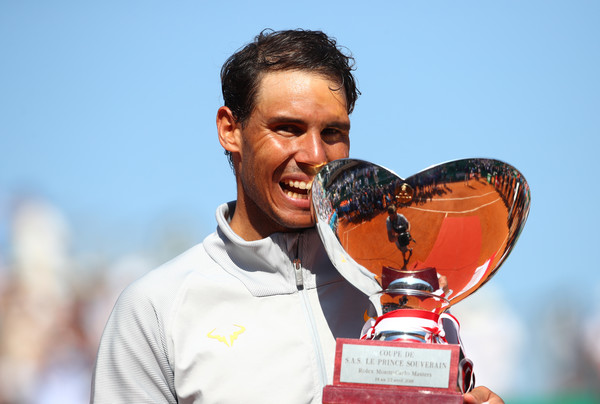 Nadal bites his 11th trophy in Monte Carlo. Photo: Julian Finney/Getty Images