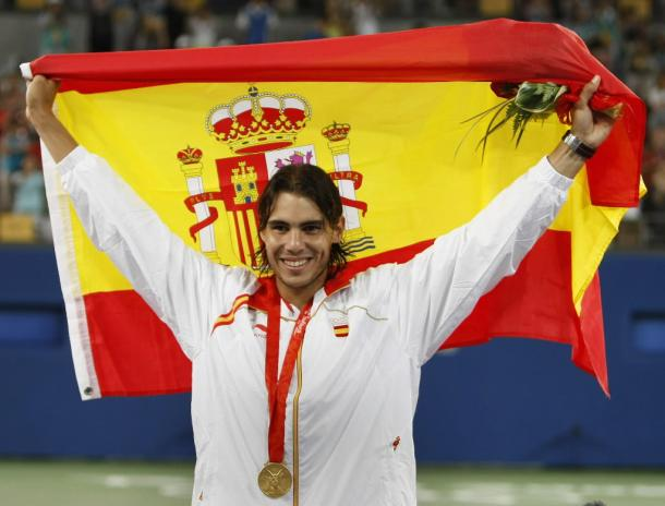 Nadal hoists the flag after his win at the Olympics in 2008. Photo: Clive Brunskill/Getty Images