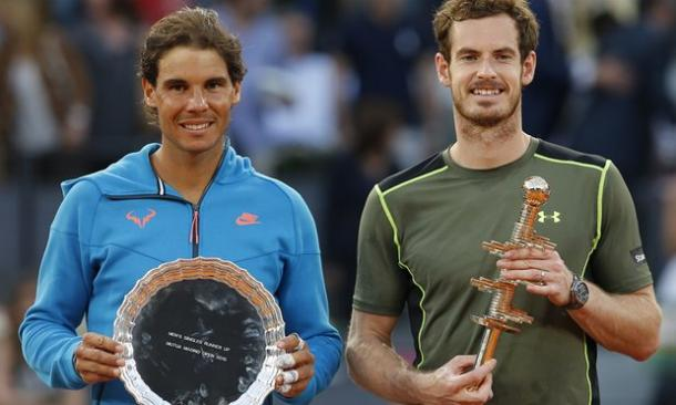 Nadal (left) and Murray hold their trophies after the 2015 Mutua Madrid Open final. Photo: Paul White/AP